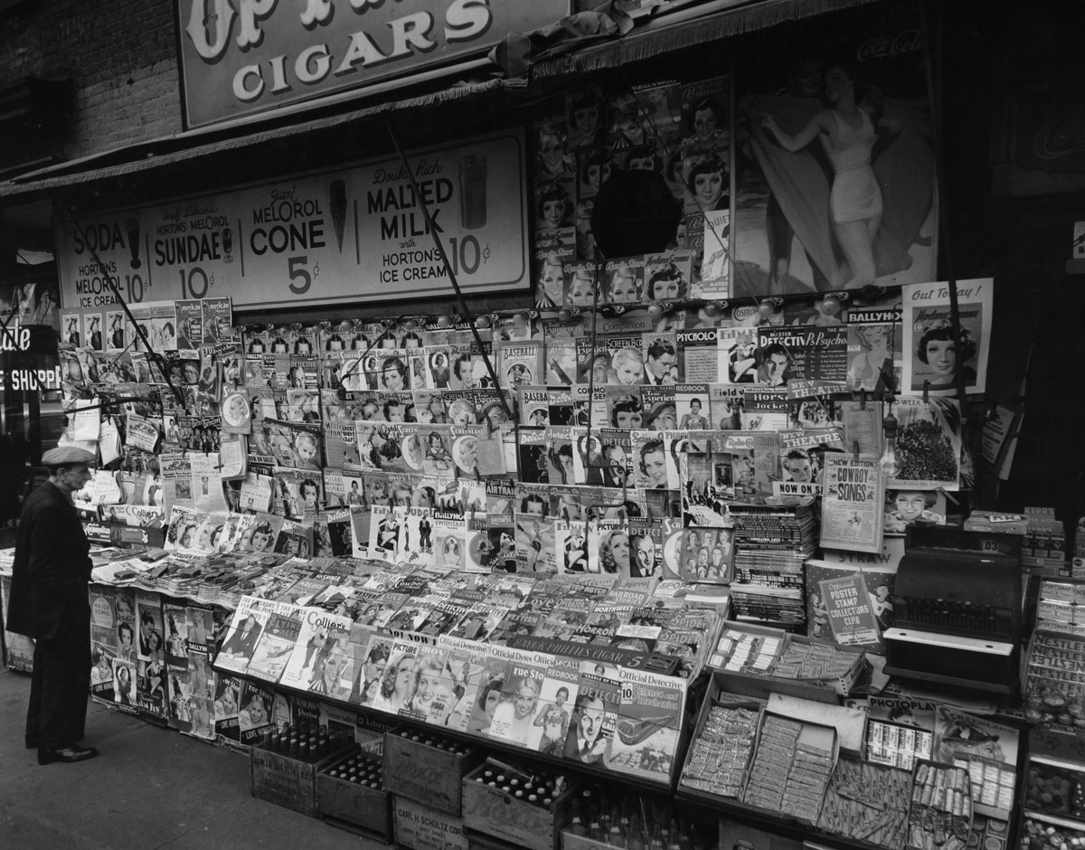 Newsstand, 32nd Street and Third Avenue, New York City (November 19, 1935) by Berenice Abbott.