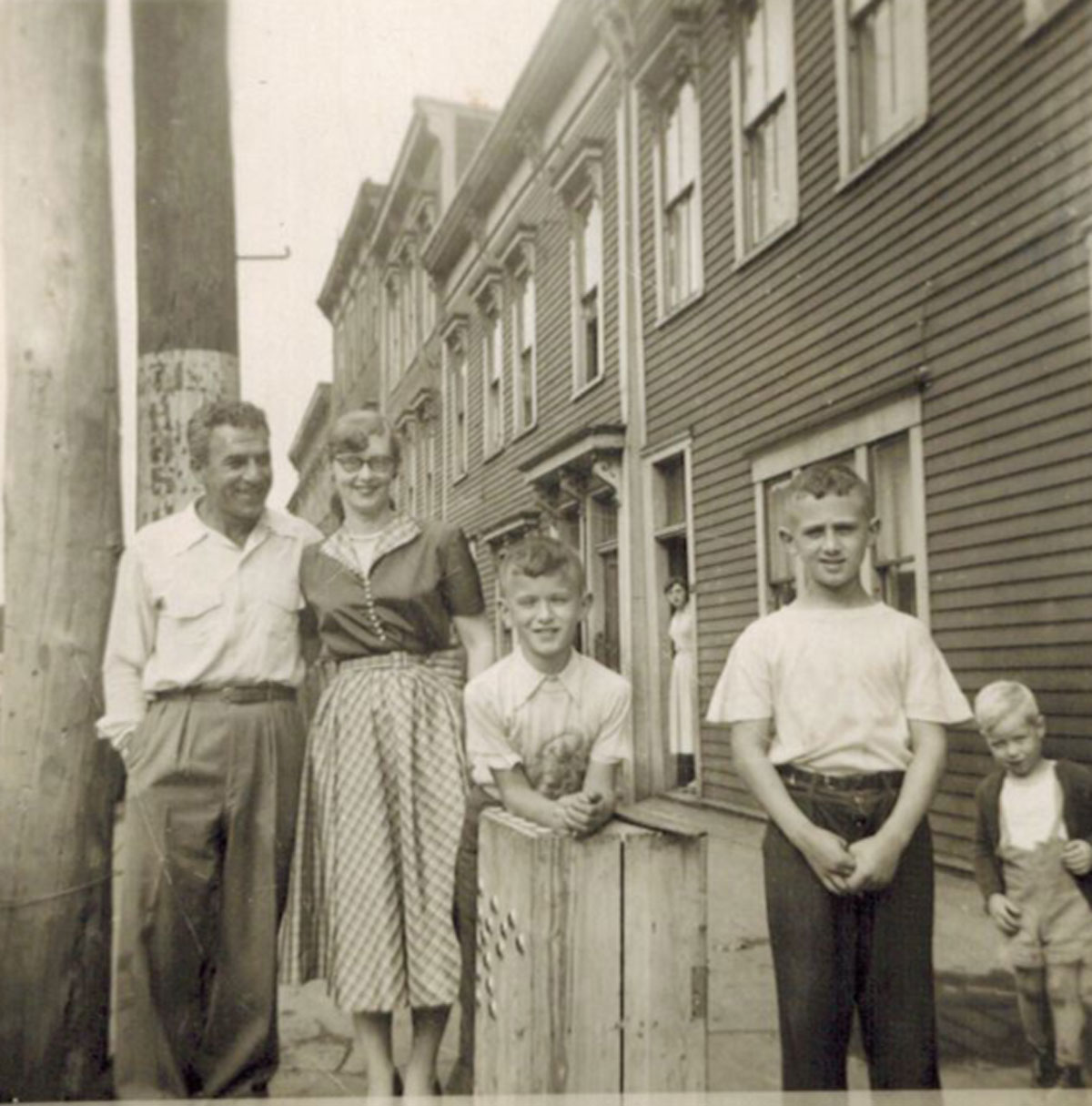 Photograph of M. Fred Tobias, Laura Tobias, Ken Tobias, and Tony Tobias.